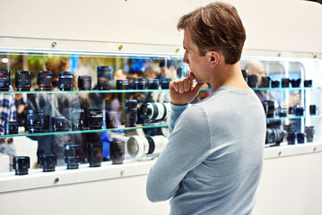 Selecting camera lens in showcase of store