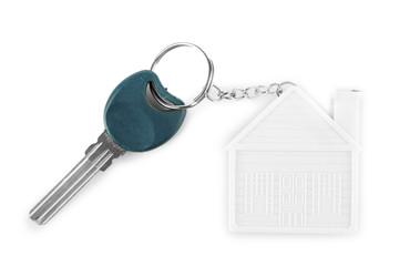 Keys with trinket on light background