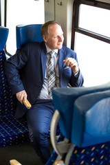 Serious businessman sitting in a train