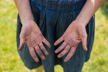 Dirty hands covered in dirt
