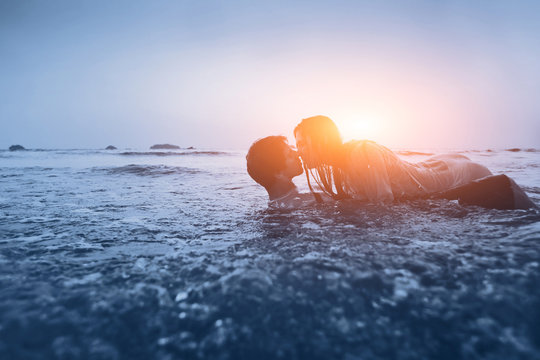 sexy couple in the water