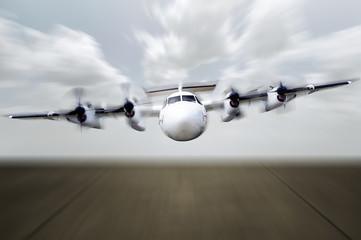 Propeller Plane Ready For Landing