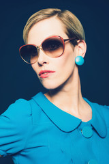 Fashionable Woman in Blue Dress and Sunglasses