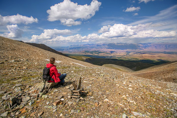 Man in travel  sitting on mountain top