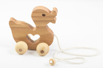Wooden Duck Toy on Rope on white background