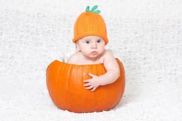 Baby in Pumpkin Hat Inside Pumpkin