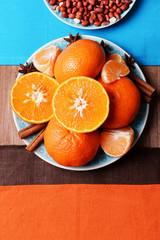 Orange tangerines, peanuts and cinnamon sticks