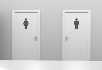 Restroom doors to public toilets marked with gender icons