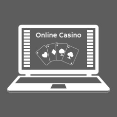 Online casino. playing cards on a laptop monitor.