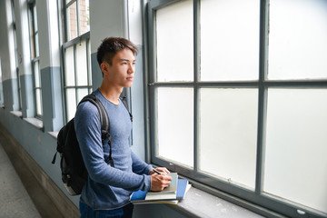 Asian college student standing at college