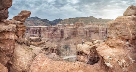 Tourist in Charyn canyon of Kazakhstan