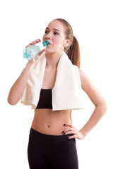Woman in sport wear drinking water