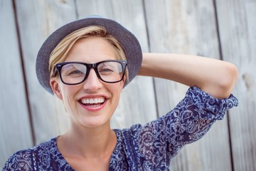 Pretty blonde woman wearing hipster glasses