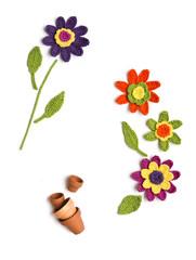 gehäkelte Blumen mit Blumentöpfen