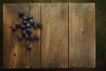Plums on picnic table