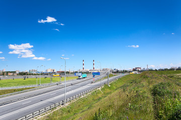 Panorama of city encircling route with driving cars, summer day