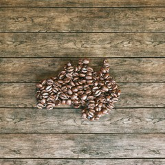 Map of Australia made of roasted coffee beans on the table