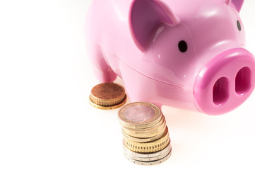 Savings represented by a pink pig with coins