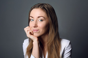 Portrait of young woman on grey background
