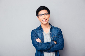 Portrait of a happy asian man with arms folded