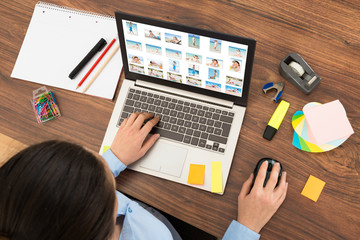 Businesswoman Looking At Picture On Laptop