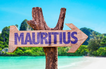 Mauritius wooden sign with beach background