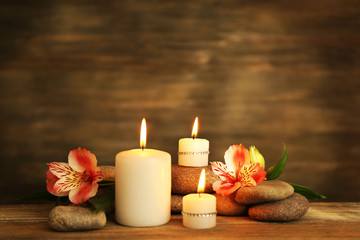 Aluminium Prints Spa Beautiful composition with candles and spa stones on wooden background
