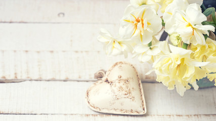 Background with fresh narcissus and heart