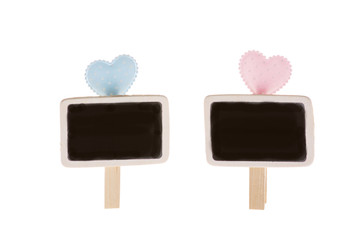 Detail of blue and pink dotted hearts and blackboards