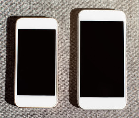 Comparison of two white smart phones