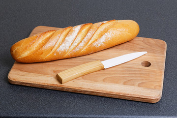 Loaf of bread and ceramic knife