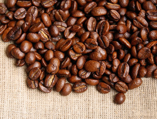 Background from coffee beans on fabric closeup