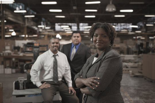 Business people standing in warehouse
