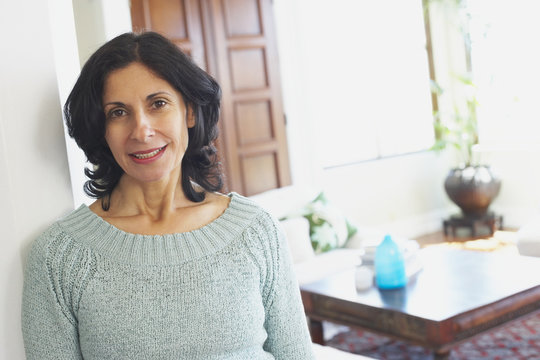 Confident Middle Eastern woman in living room