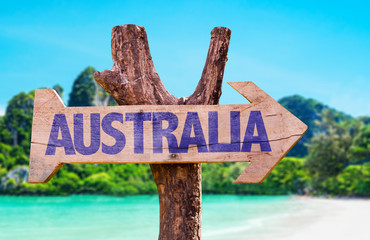 Australia wooden sign with beach background