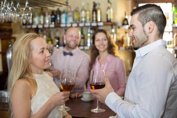 Bartender entertaining guests