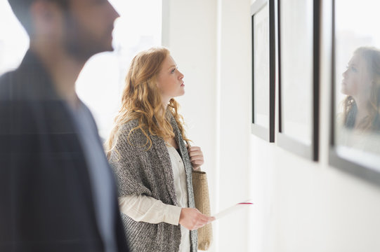 Woman admiring art in gallery