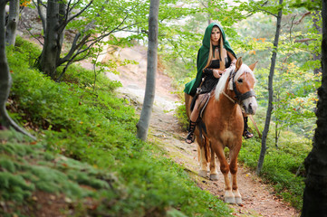 sexy woman warrior on horseback in the woods