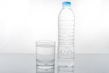 water in plastic bottle with glass