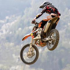 Fototapete - salto con moto da cross
