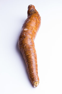 whole manioc, cassava, on white background, closeup