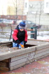 Child playing in the sandbox