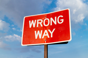 A wrong way street sign.