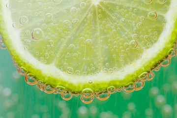 Green lime with water splash