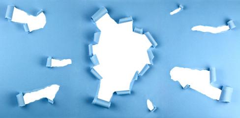 Risse in blauem Papier