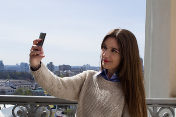 Selfie girl phone in city