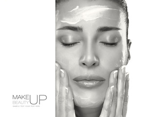 Skin Care Concept. Spa Woman Applying Moisturizer on Face
