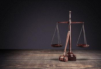 Lawyer. Law scales on table in front black background. Symbol of