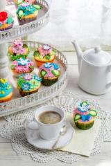 Tasty muffins with sweet decoration and coffee