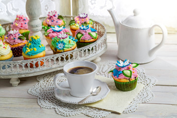Fresh muffins with sweet decoration and coffee
